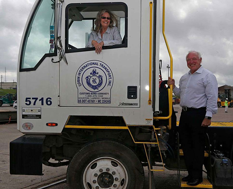 CEO Of Single Point Capital With Houston Port Authority On A Truck