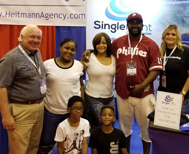 President of Single Point Capital At The Texas Trucking Show With Trucker and Family